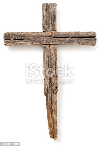 A wooden cross set on a white background.