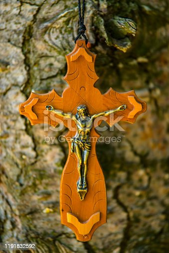 istock Wooden Crucifix on the Tree 1191832592