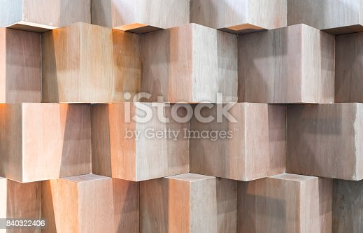 istock Wooden cube boxes creating abstract geometric wall 840322406