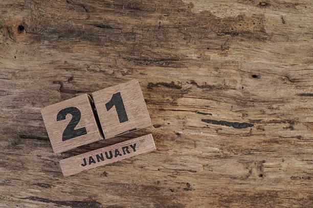 wooden cube calendar for january - number 21 stock photos and pictures