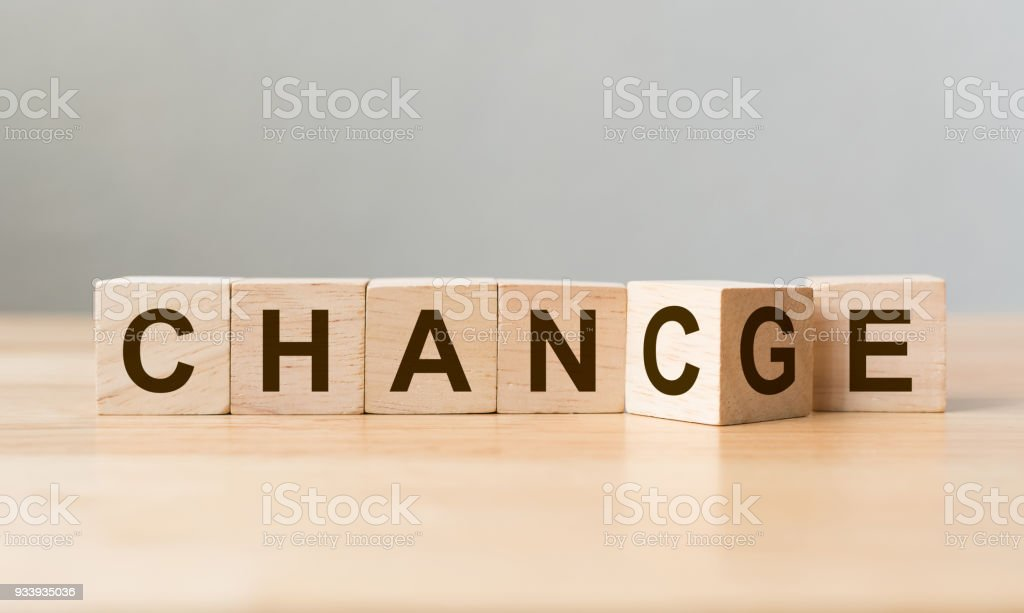 """Wooden cube flip with word """"change"""" to """"chance"""" on wood table, Personal development and career growth or change yourself concept royalty-free stock photo"""
