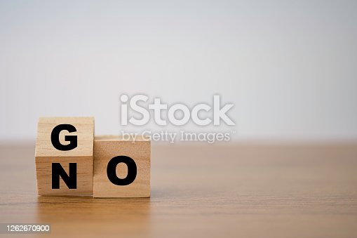 Wooden cube flipping for change between go and no.