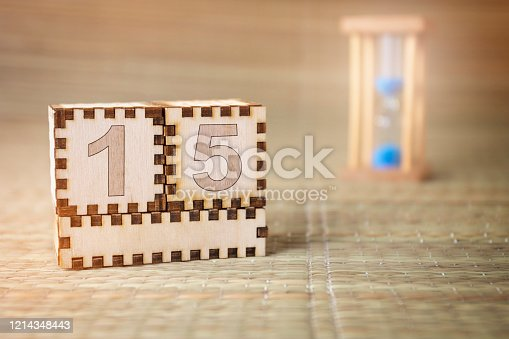 istock wooden cube with date 15 1214348443