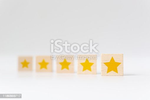 1133580311 istock photo Wooden cube with five star shape on white background. The best excellent business services rating customer experience concept 1186869717