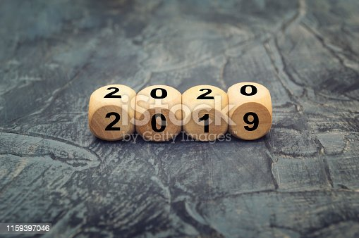 istock Wooden cube with word  2019 & 2020 on dark background. 1159397046