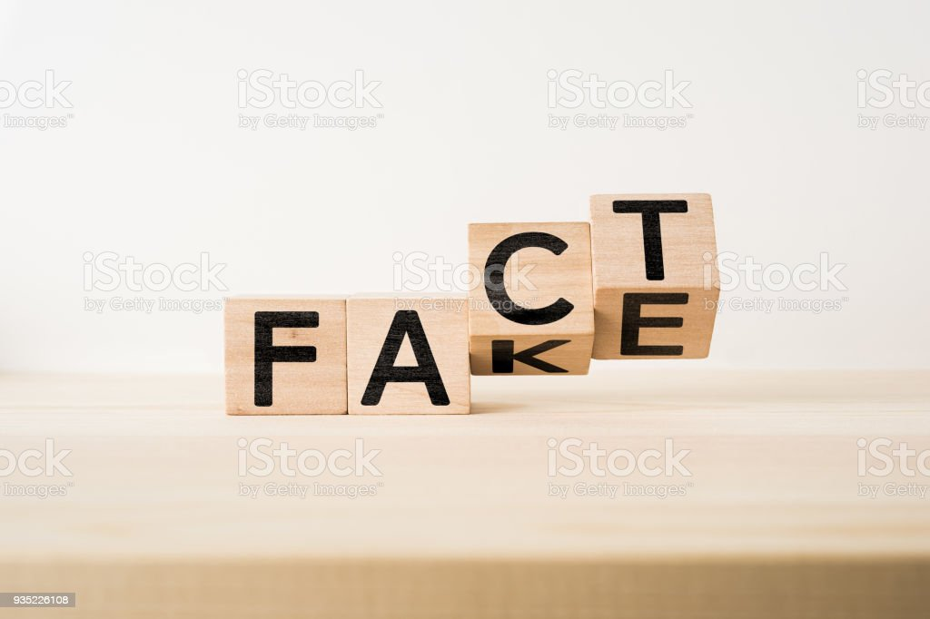 wooden cube with word ' FACT & FAKE ' concept stock photo
