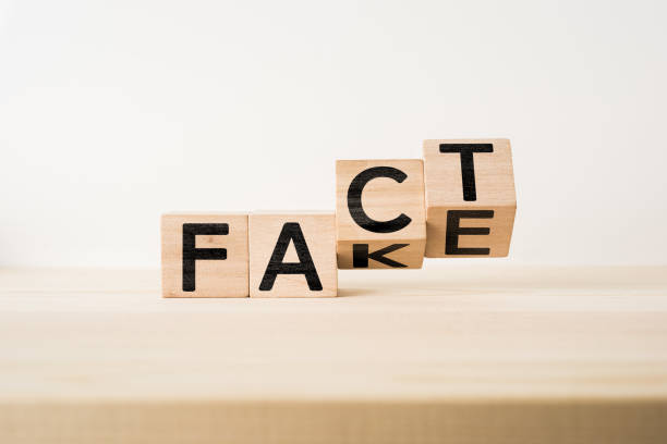 "wooden cube with word "" fact & fake "" concept - imitation stock photos and pictures"