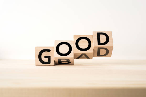 """wooden cube with word """" good & bad """" concept - diabolic stock pictures, royalty-free photos & images"""