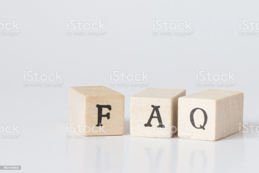 wooden cube written as FAQ,faq word made with building blocks,frequently asked question. stock photo