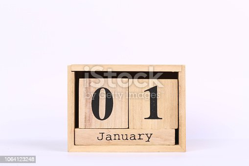 istock Wooden cubes calendar with the date of January 01. Concept calendar for year with copy space isolated on white background 1064123248