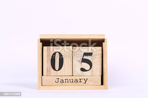 istock Wooden cubes calendar with the date of January 05. Concept calendar for year with copy space isolated on white background 1064124338