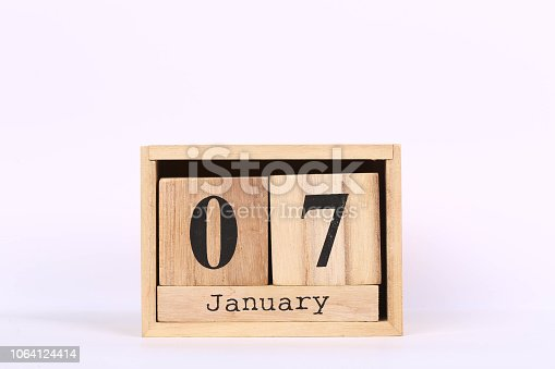 istock Wooden cubes calendar with the date of January 07. Concept calendar for year with copy space isolated on white background 1064124414