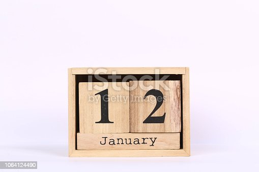 istock Wooden cubes calendar with the date of January 12. Concept calendar for year with copy space isolated on white background 1064124490