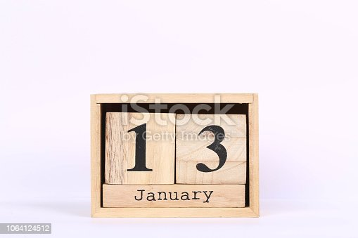 istock Wooden cubes calendar with the date of January 13. Concept calendar for year with copy space isolated on white background 1064124512