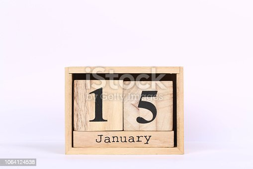 istock Wooden cubes calendar with the date of January 15. Concept calendar for year with copy space isolated on white background 1064124538