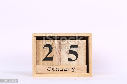 istock Wooden cubes calendar with the date of January 25. Concept calendar for year with copy space isolated on white background 1064124724
