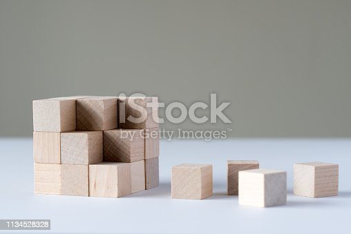 istock Wooden cubes form a bigger square 1134528328