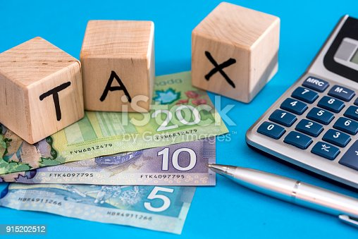 istock Wooden cubes tax with canadian dollar 915202512