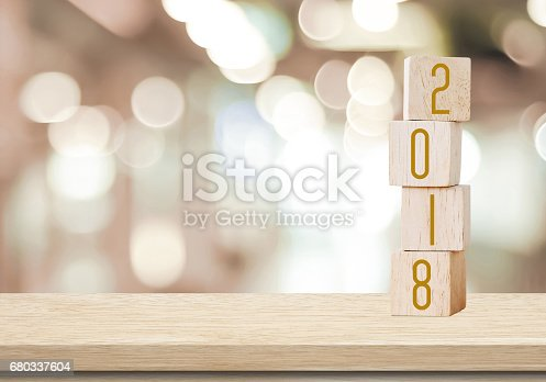 istock Wooden cubes with 2018 on perspective wood over blur bokeh background with copy space for text, new year template 680337604