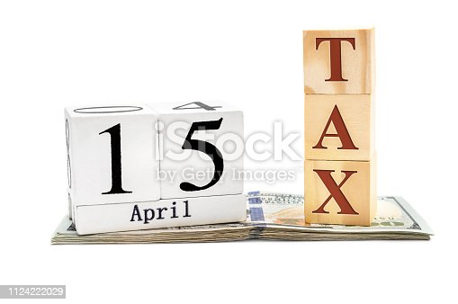 947260978 istock photo Wooden cubes with date of 15 april and word