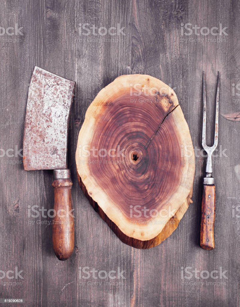 Wooden cut with cleaver knife and fork стоковое фото
