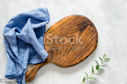 471504772 istock photo Wooden cutting board and blue kitchen napkin 651594462
