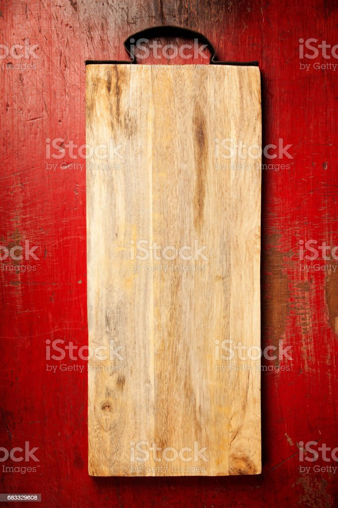 Wooden cutting board on rustic background royalty-free stock photo