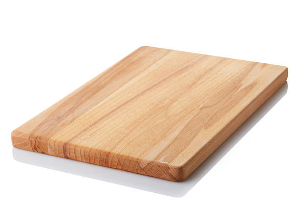Wooden cutting board Brown wooden cutting board isolated on white background. Clipping path cutting board stock pictures, royalty-free photos & images