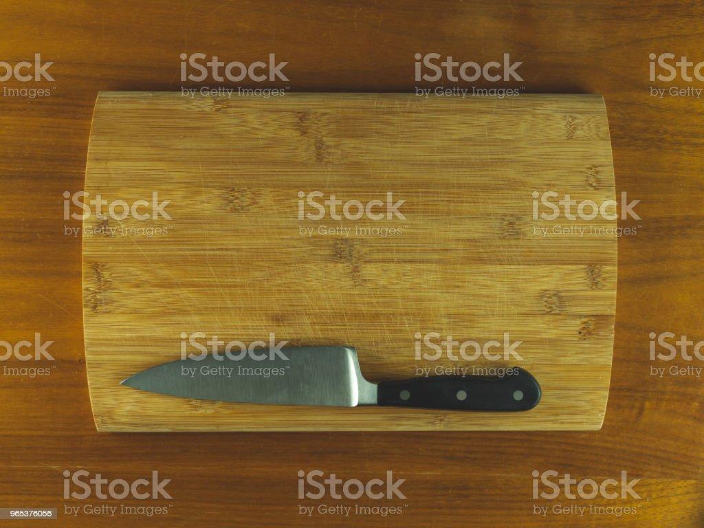 Wooden cutting board with a knife zbiór zdjęć royalty-free