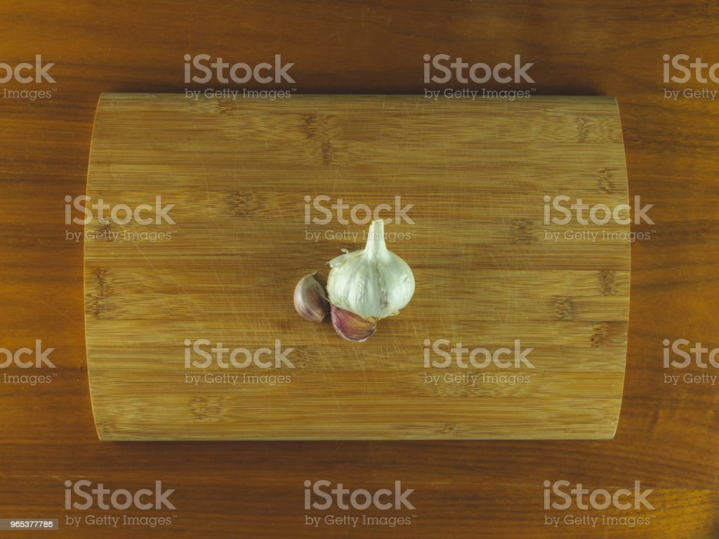 Wooden cutting board with garlic royalty-free stock photo