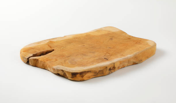 Wooden cutting board with natural edge stock photo