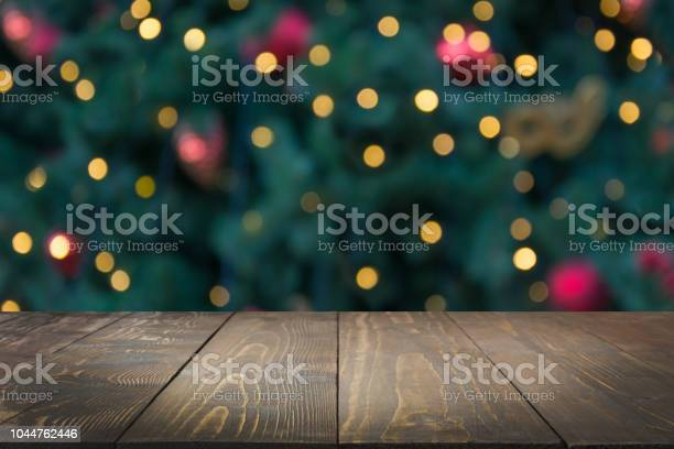 Wooden dark tabletop and blurred christmas tree bokeh xmas background picture id1044762446?b=1&k=6&m=1044762446&s=612x612&h=wazztpbwk9w353bpa05lbistdwj2xzp1zeaexk875l8=