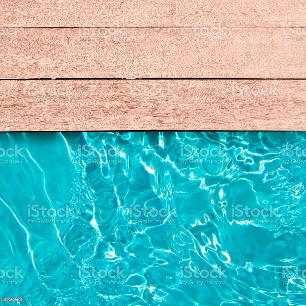 Wooden deck and swimming pool close up stock photo