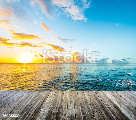 Wooden deck at Caribbean sea at sunset