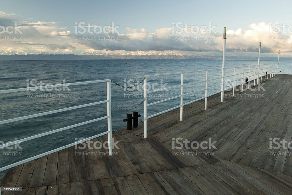 Wooden deck at the lake royalty-free stock photo