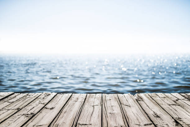 wooden deck by the sea - pier stock photos and pictures