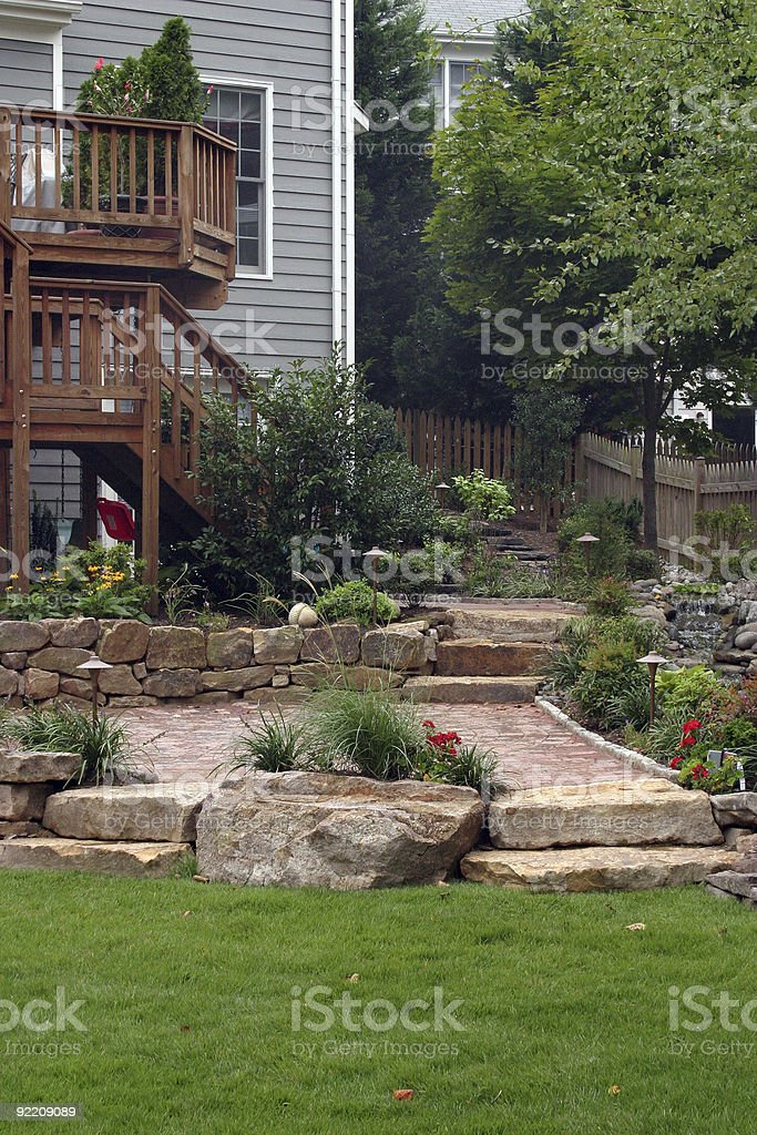 Wooden Deck leading to Stone Garden & Patio royalty-free stock photo