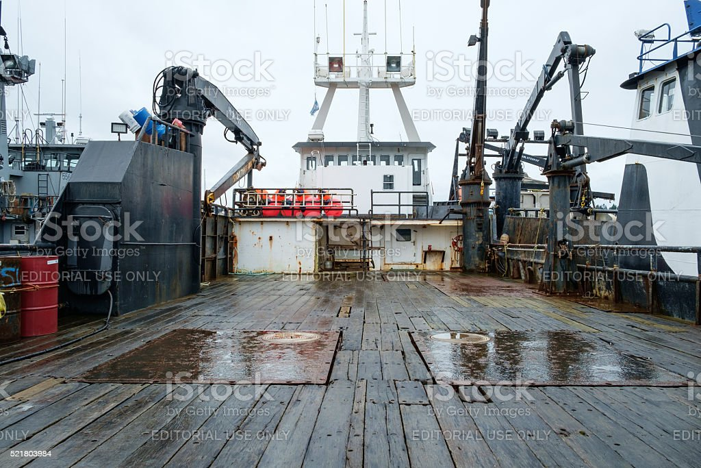 Wooden deck of commercial fishing boat stock photo