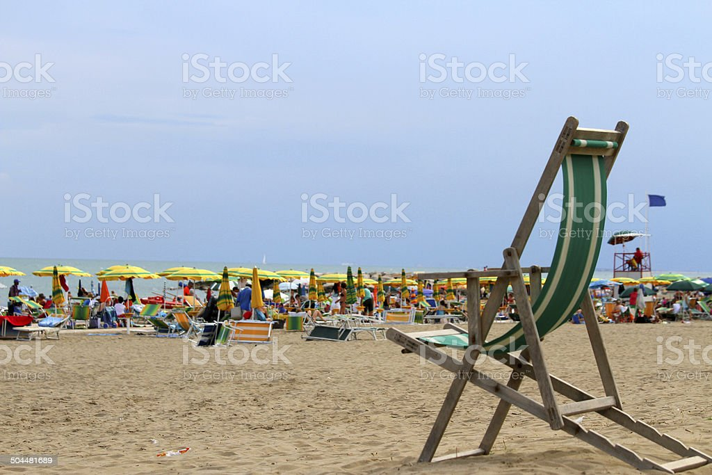 wooden deck on the beach with umbrellas in summer stock photo