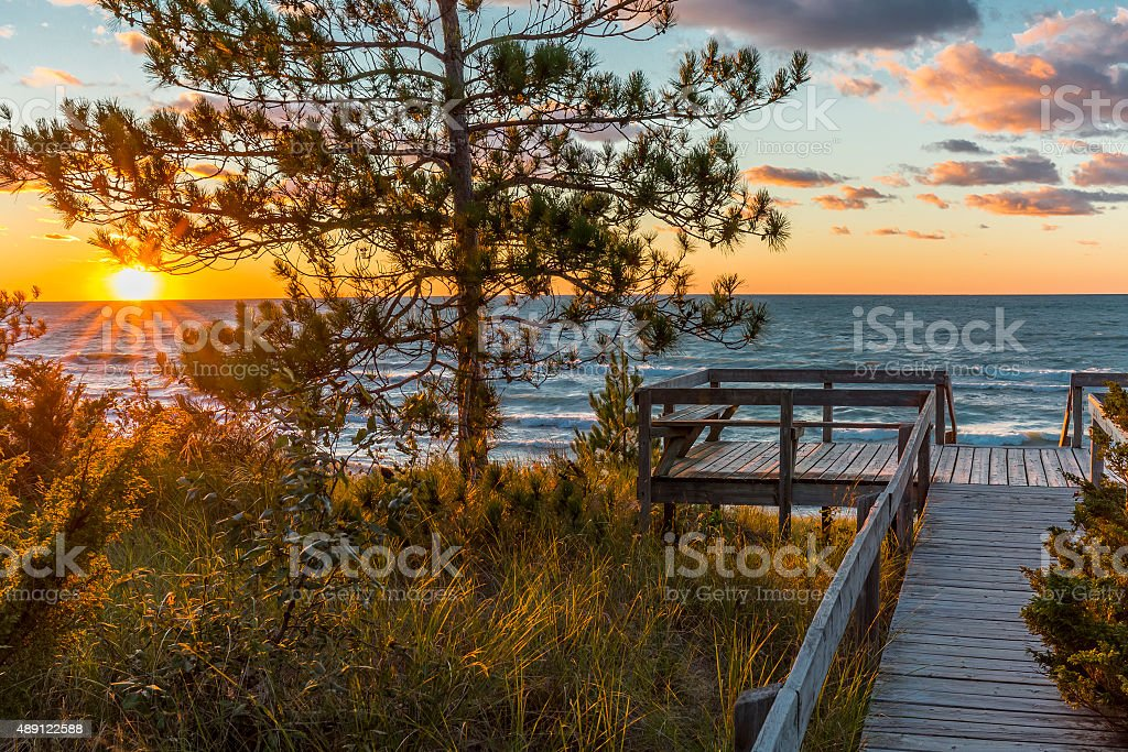 Wooden Deck Overlooking a Lake Huron Sunset - Ontario, Canada stock photo