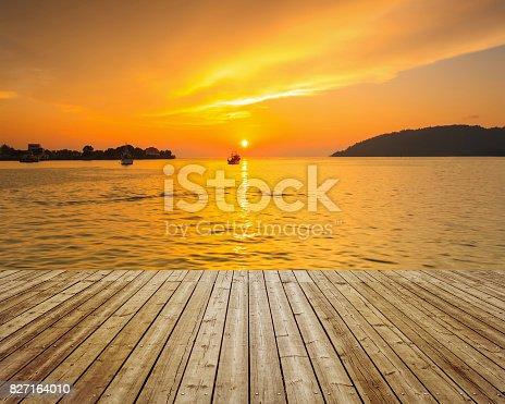 istock Wooden deck towards dramatic landscape 827164010