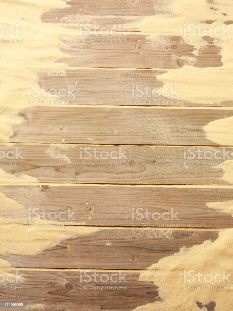 Wooden Decking Background with Sand royalty-free stock photo