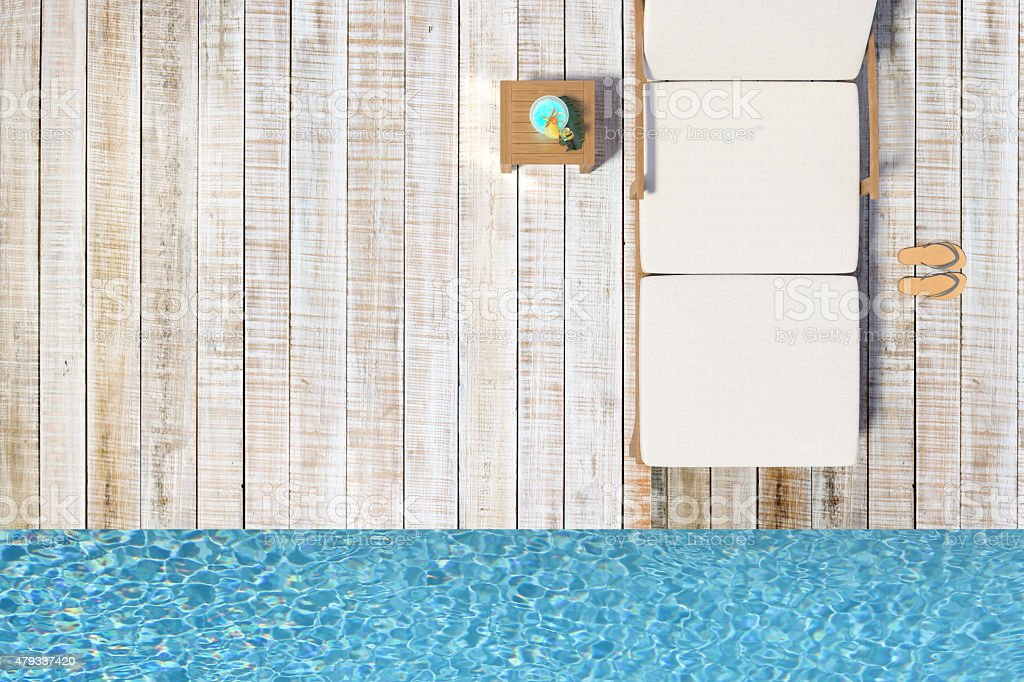 Wooden decking with a chair and blue water stock photo