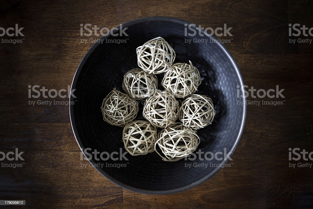 Wooden decorative spheres in metal bowl on dining table royalty-free stock photo