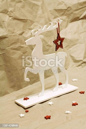 istock Wooden deer decorated with New Year's toys. 1281426848