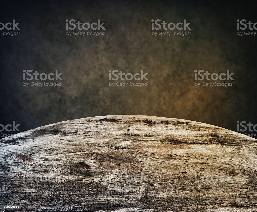 Wooden desk on dark background stock photo