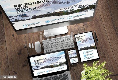 istock wooden desktop devices mountain snow 1061328682