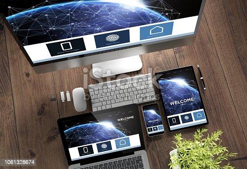 istock wooden desktop devices online landing page responsive design 1061328674