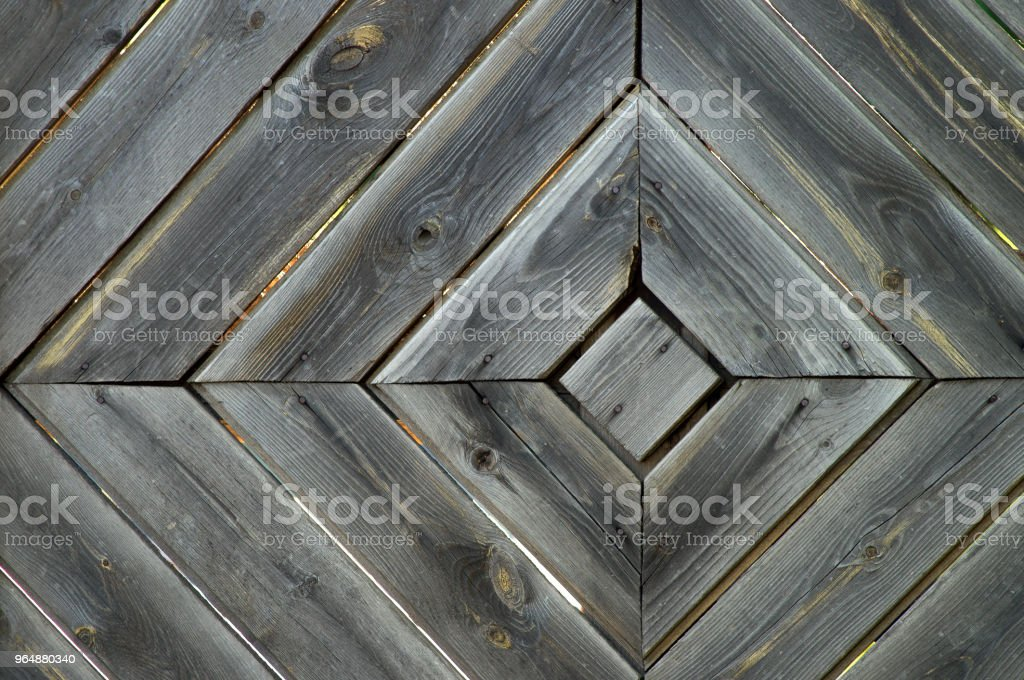 Wooden diagonal texture of boards aged old fence in the form of rhomb structure. Rhombus wood wall background royalty-free stock photo