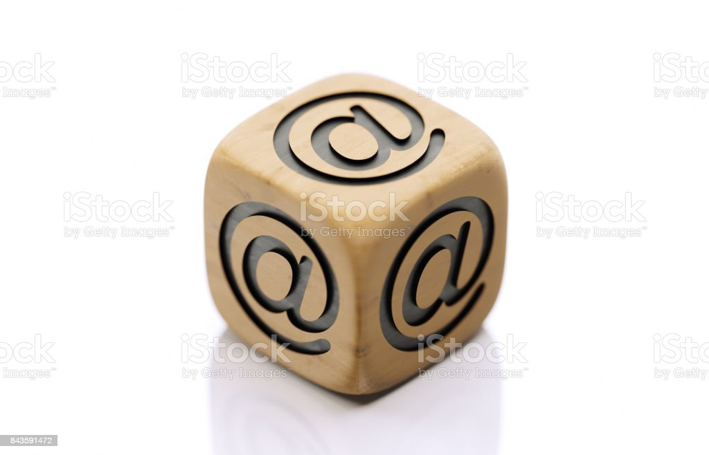 Wooden Dice with At Sign  Isolated on White Background stock photo